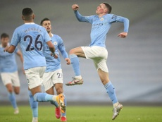 Phil Foden (R) gave Man City a 1-0 win over Brighton. AFP