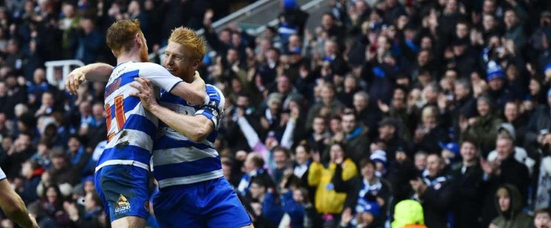 McShane (R) celebrates a goal with Reading team-mate Stephen Quinn. AFP