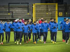 Trabzonspors players run during a training session in Lokeren, Belgium, in 2014