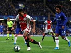 Ajax forward Neres out until winter break with knee injury. AFP