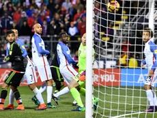 United States goalkeeper Brad Guzan (2R) watches helpless as a header from Rafael Marquez of Mexico (not pictured) gives them the winning goal in their World Cup qualifier
