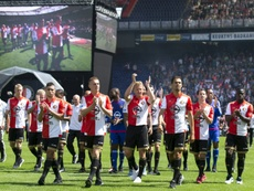 Feyenoord Rotterdams players walk on the pitch during the teams presentation to supporters on an Open Day at Feyenoord stadium in Rotterdam July 19, 2015