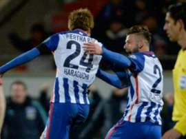 Herthas midfielder Genki Haraguchi (L) celebrates scoring with his team-mate defender Marvin Plattenhardt during the German Cup quarter final football match Heidenheim vs Hertha Berlin on February 10, 2016 in Heidenheim, Germany