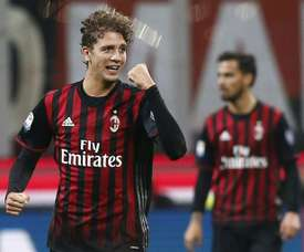AC Milans midfielder Manuel Locatelli celebrates after scoring (L) during the Italian Serie A football match AC Milan versus Juventus on October 22, 2016