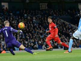 Liverpools midfielder Roberto Firmino (C) takes an unsuccessful shot on goal during the English Premier League football match between Manchester City and Liverpool at The Etihad stadium in Manchester, north west England on November 21, 2015