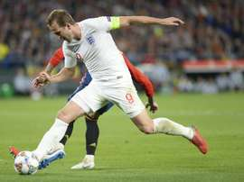 England's Harry Kane (R) showed the value of a top-class centre forward. AFP