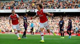 Alto custo de David Luiz deve levar o Arsenal a negociá-lo. AFP