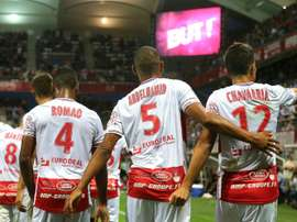 Reims celebrate after Chavarria scores the only goal of the game. AFP