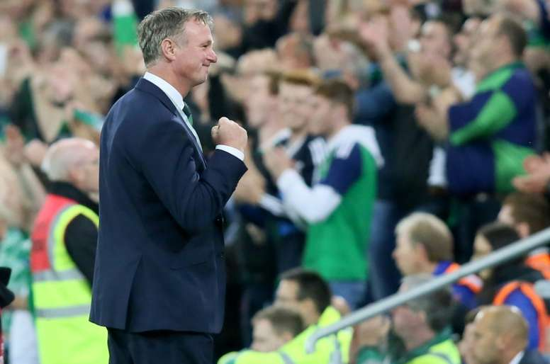 Michael O'Neill has joined Stoke, but will remain NI manager for another few months as well. AFP