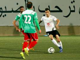 Shebab Hebrons Israeli Arab player Abu Obeideh Rabie (R) dribbles the ball during a football match against the Ammari Youth Club, at the Hebron Youth Club on April 7, 2016
