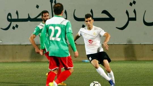 Shebab Hebrons Israeli Arab player Abu Obeideh Rabie (R) dribbles the ball during a football match against the Ammari Youth Club, at the Hebron Youth Club on April 7, 2016