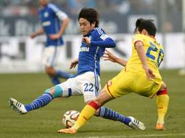Japan pin-up Uchida returns home after Germany spell. AFP