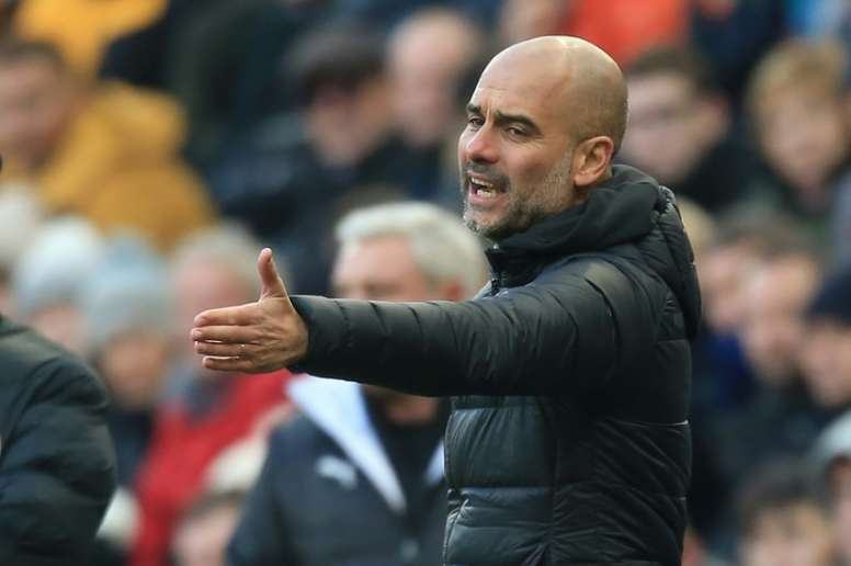 Guardiola is pleased with his players' body language despite poor results recently for Man City. AFP