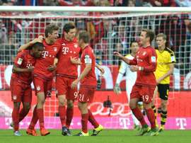Bayern Munichs players celebrate scoring a goal during their German first division Bundesliga match against Borussia Dortmund, in Munich, on October 4, 2015