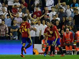 Spains midfielder Santi Cazorla (C) celebrates with Spains forward Juan Mata after scoring during the friendly football match Spain vs England at the Jose Rico Perez stadium in Alicante on November 13, 2015
