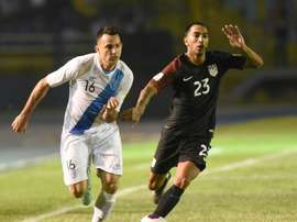 Guatamalas Marco Papa (L) and USAs Edgar Castillo during their World Cup qualifying match in Guatemala City on March 25, 2016