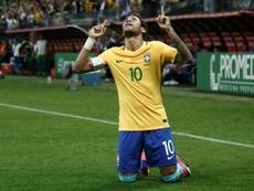 Brazils Neymar celebrates after scoring against Paraguay