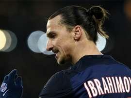 Paris Saint-Germains forward Zlatan Ibrahimovic celebrates after scoring a goal during the match against Angers on January 23, 2016 at the Parc des Princes stadium in Paris