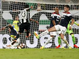 Juventus defender Daniel Alves from Brazil (C) scores a goal during an Italian Serie A football match against Cagliari on September 21, 2016 at the Juventus Stadium in Turin
