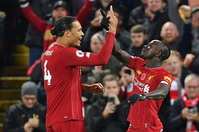 Liverpool beat Man City to open up eight-point Premier League lead. AFP