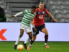 Dutch defender Jeremie Frimpong (L) has signed for Bayer Leverkusen. AFP