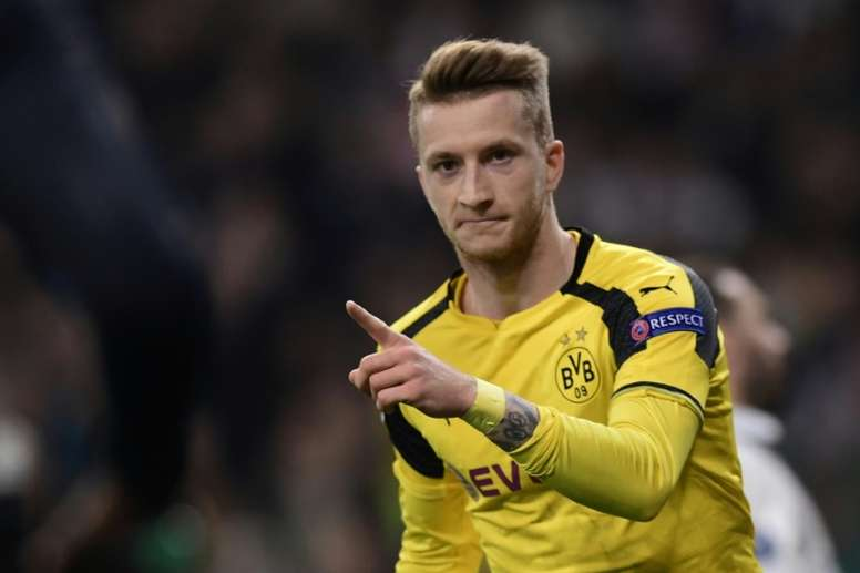 Marco Reus celebrates his late goal against Real Madrid. AFP