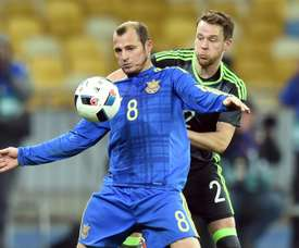Ukraines Roman Zozulya (L) vies with Wales Chris Gunter. AFP