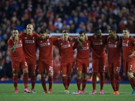 Liverpool players huddle together during a penalty shootout against Carlisle United at Anfield on September 23, 2015
