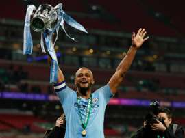 Komapny holds aloft the League Cup at Wembley. AFP