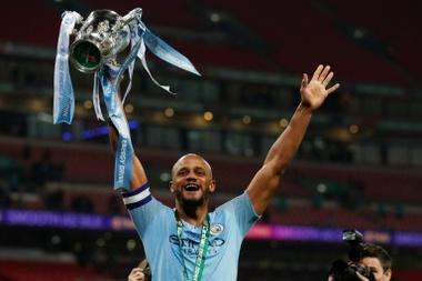 Komapny holds aloft the League Cup at Wembley. AFP