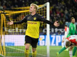 Dortmund hold off Slavia to reach Champions League last 16. AFP