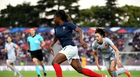 Injury hit France edge past China in last warm up. AFP