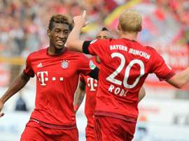 Bayern Munichs forward Kingsley Coman (L) celebrates scoring with his teammate Sebastian Rode during a German first division Bundesliga football match against Darmstadt in Darmstadt, southern Germany on September 19, 2015