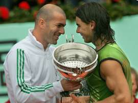 Rafael Nadal, pictured here receiving the French Open trophy from Zinedine Zidane on June 5, 2005, said he wished the Frenchman the best of luck in his new role as coach of Real Madrid