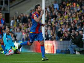 Crystal Palace's French midfielder Yohan Cabaye celebrates after scoring the opening goal from the penalty spot during the English Premier League football match in Watford, north of London on September 27, 2015
