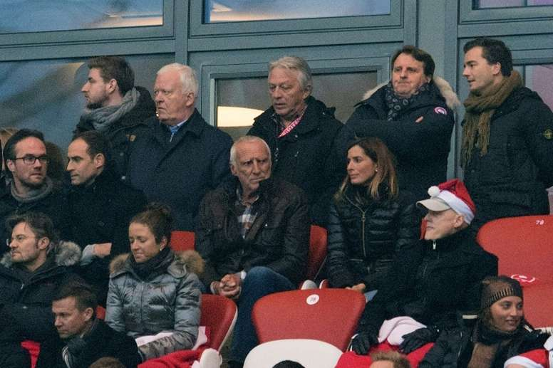 Red Bulls Austrian founder Dietrich Mateschitz (C) attends the German first division Bundesliga football match between RB Leipzig and Hertha BSC Berlin in Leipzig, eastern Germany on December 17, 2016