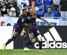 Bordeauxs French defender Gregory Sertic (R) is congratulated by teammate Malcom (L) after scoring a goal during the French L1 football match Olympique Lyonnais (OL) vs Girondins de Bordeaux on September 10, 2016