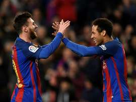 'Next year we have to do it': Neymar keen for Messi reunion. AFP