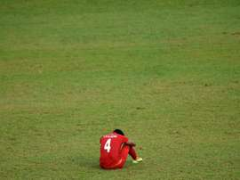 Myanmar's Thiha Htet Aung sits dejected after a defeat in the Southeast Asian Games. AFP