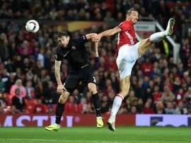 Manchester Uniteds striker Zlatan Ibrahimovic (R) vies in the air with Zoryas Belarusian defender Mikhail Sivakov as he heads the ball towards goal during the UEFA Europa League group A football match between Manchester United and Zorya Luhansk