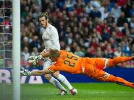 Real Madrids forward Gareth Bale scores past Rayo Vallecanos goalkeeper Yoel during a Spanish league football match at the Santiago Bernabeu stadium in Madrid on December 20, 2015