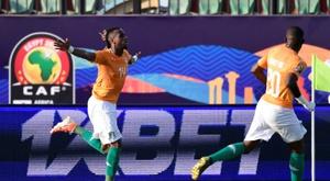 Jonathan Kodjia celebrates the winner for Ivory Coast. AFP