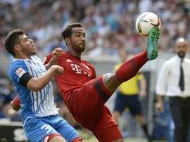 Kevin Volland (left) challenges Bayern Munichs Medhi Benatia on August 22, 2015 in Sinsheim, southwestern Germany