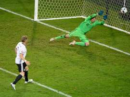 Germanys midfielder Bastian Schweinsteiger scores a goal during the Euro 2016 group C football match between Germany and Ukraine at the Stade Pierre Mauroy in Villeneuve-dAscq near Lille on June 12, 2016