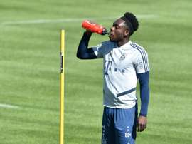 Bayern star, ex-refugee Davies raises funds for those forced to flee. AFP