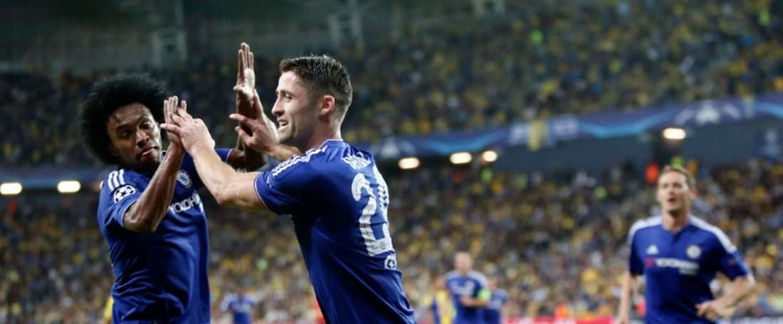 Chelseas defender Gary Cahill (R) celebrates with his Brazilian teammate Willian after scoring a goal during their UEFA champions league match between Maccabi Tel Aviv and Chelsea FC, in Haifa on November 24, 2015