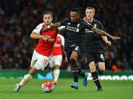 Arsenals Aaron Ramsey (L) fights for the ball with Liverpools Nathaniel Clyne during their English Premier League match, at the Emirates stadium in north London, on August 24, 2015