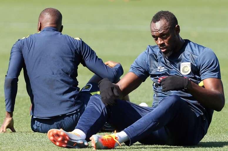 Usain Bolt sigue soñando con jugar profesionalmente. AFP