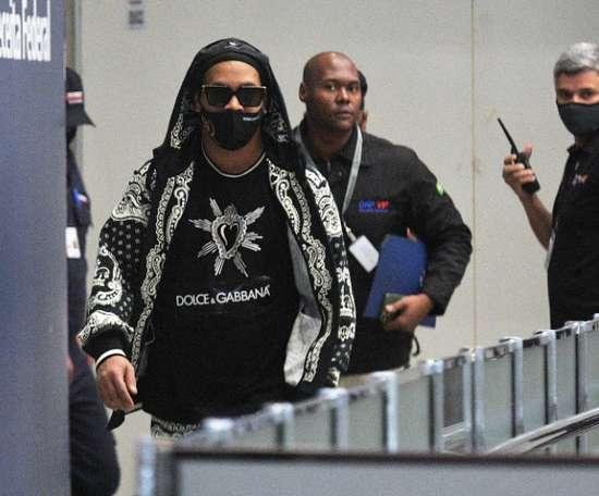 Ronaldinho arrives back in Brazil after Paraguay detention. AFP