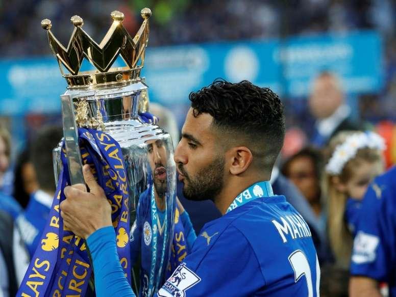 Leicester City's Riyad Mahrez poses with the Premier League trophy. AFP